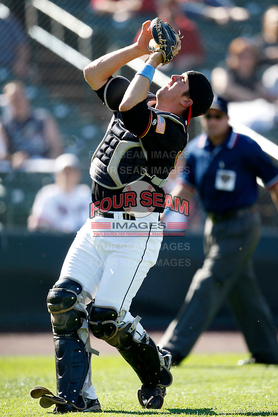 June 21, 2009:  Catcher Jeff Christy of the Rochester Red Wings battles the sun to catch a foul pop up during a game at Frontier Field in Rochester, NY.  The Rochester Red Wings are the International League Triple-A affiliate of the Minnesota Twins.  Photo by:  Mike Janes/Four Seam Images