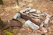 Fire ring in the area of Stillwater Junction of the Pemigewasset Wilderness in Lincoln, New Hampshire USA. The rusted stove piece (artifact) in the fire ring could possibly be from the old Stillwater Camp that was in the area. The removal of historical artifacts from federal lands without a permit is a violation of federal law.