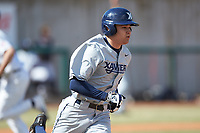 Conor Grammes (4) of the Xavier Musketeers hustles down the first base line against the Penn State Nittany Lions at Coleman Field at the USA Baseball National Training Center on February 25, 2017 in Cary, North Carolina. The Musketeers defeated the Nittany Lions 10-4 in game one of a double header. (Brian Westerholt/Four Seam Images)
