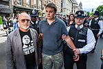 © Joel Goodman - 07973 332324 . 30/06/2011 . London , UK . A protester is detained by police on Whitehall . Tens of thousands of public sector workers demonstrate and march through the City of London in protest at proposed changes to their pensions . Photo credit : Joel Goodman