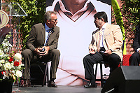 SAN FRANCISCO, CA - Eddie DeBartolo, right, and Joe Montana sit on stage at the public memorial service for former San Francisco 49ers head coach Bill Walsh at Candlestick Park (Monster Park) in San Francisco, California on August 10, 2007. Photo by Brad Mangin