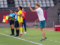 KASHIMA, JAPAN - AUGUST 5: Tony Gustavsson of Australia talks to his team during a game between Australia and USWNT at Kashima Soccer Stadium on August 5, 2021 in Kashima, Japan.