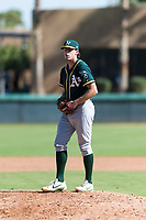 Oakland Athletics relief pitcher Chase Cohen (51) gets ready to deliver a pitch during an Instructional League game against the Los Angeles Dodgers at Camelback Ranch on September 27, 2018 in Glendale, Arizona. (Zachary Lucy/Four Seam Images)
