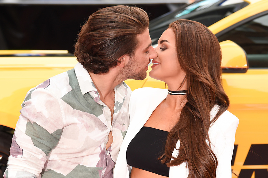 """Kem Cetinay and Amber Davies<br /> attending the premiere of """"Logan Lucky"""" at the Vue West End, Leicester Square, London. <br /> <br /> <br /> ©Ash Knotek  D3295  21/08/2017"""