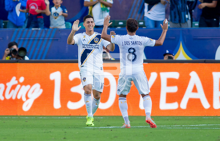 CARSON, CA - SEPTEMBER 29: Cristian Pavon #10 and Jonathan dos Santos #8 of the Los Angeles Galaxy celebrate during a game between Vancouver Whitecaps and Los Angeles Galaxy at Dignity Health Sports Park on September 29, 2019 in Carson, California.