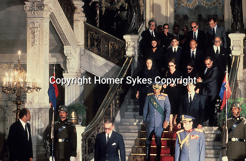 Shah of Iran his state funeral Cairo Egypt. Mohammad Reza Pahlavi, also known as Mohammad Reza Shah. The Shah's  widow and family and President Sadat at front (left) and the Shah's son Reza Pahlavi 1980. The Lying in State at the Abdin Palace.