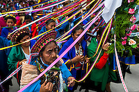 """Native women from the Kamentsá tribe, wearing colorful costumes, take part in the procession during the Carnival of Forgiveness, a traditional indigenous celebration in Sibundoy, Colombia, 12 February 2013. Clestrinye (""""Carnaval del Perdón"""") is a ritual ceremony kept for centuries in the Valley of Sibundoy in Putumayo (the Amazonian department of Colombia), a home to two closely allied indigenous groups, the Inga and Kamentsá. Although the festival has indigenous origins, the Catholic religion elements have been introduced and merged with the shamanistic tradition. Celebrating annually the collaboration, peace and unity between tribes, they believe that anyone who offended anyone may ask for forgiveness this day and all of them should grant pardons."""