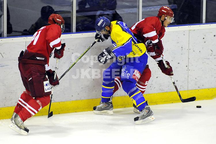 ijshockey grizzlies - tilburg seizoen 2009-2010 03-10-2009 duel aan de borarding.