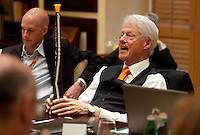 Former United States President Bill Clinton holds a vuvuzuela while speaking to members of the international press during a press conference at the Saxon Hotel in Sandhurst, Johannesburg, South Africa on June 24, 2010.  Clinton is the honorary chairman of the U.S. bid to host the World Cup in either 2018 or 2022.
