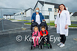 Councillor Deirdre Ferris standing with Margaret Lyne and her twins Layla and Kyle, at the entrance to the new housing development Láthair na hArd Eaglaise in Ardfert, where Margaret was allocated  a  house in February and is still waiting to move in because of a delay in the water connection by Irish Water.L to r: Margaret, Layla and Kyle Lyne and Cllr Deirdre Ferris