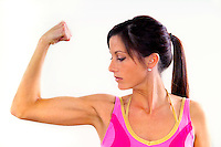 Beautiful female flexing her bicep muscle