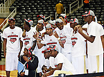 The Alabama State Hornets team getting ready for the trophy presentation after winning the SWAC Championship game between the Alabama State Hornets and the Grambling State Tigers at the Special Events Center in Garland, Texas. Alabama State defeats Grambling State 65 to 48.