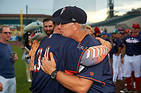 Tampa Yankees manager Jay Bell hugs pitcher Andrew Schwaab (34) after proposing to his girlfriend before the Florida State League All-Star Game on June 17, 2017 at Joker Marchant Stadium in Lakeland, Florida.  FSL North All-Stars defeated the FSL South All-Stars  5-2.  (Mike Janes/Four Seam Images)