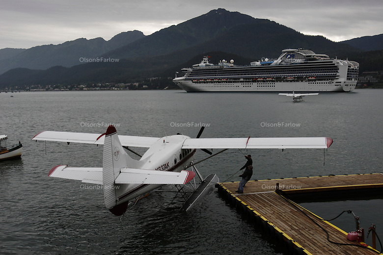 Tourists wait for tours by plane or bus to see glaciers, bears, whales and the sights near Juneau.  Sometimes 5 or 6 cruise ships dock during the day increasing the city's population by 12,000 people.  Tourists tour by plane or bus to see glaciers, bears, whales and the sights near Juneau.