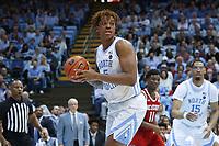 CHAPEL HILL, NC - FEBRUARY 25: Armando Bacot #5 of the University of North Carolina grabs a rebound during a game between NC State and North Carolina at Dean E. Smith Center on February 25, 2020 in Chapel Hill, North Carolina.