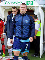 Garry Thompson of Wycombe Wanderers leads out his team wearing the commemorative track suit top before the Sky Bet League 2 match between Crawley Town and Wycombe Wanderers at Broadfield Stadium, Crawley, England on 6 August 2016. Photo by Alan  Stanford / PRiME Media Images.