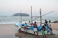 It takes manpower to launch the fishing boats each morning at Beruwala, Sri Lanka