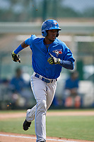 Toronto Blue Jays shortstop Luis De Los Santos (17) runs to first base during an Instructional League game against the Pittsburgh Pirates on October 13, 2017 at Pirate City in Bradenton, Florida.  (Mike Janes/Four Seam Images)