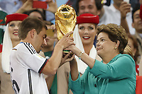 Brazil President Dilma Rousseff presents the World Cup trophy to Philipp Lahm of Germany