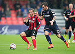 Ross County v St Johnstone...10.08.14  SPFL<br /> Chris Millar and Graham Carey<br /> Picture by Graeme Hart.<br /> Copyright Perthshire Picture Agency<br /> Tel: 01738 623350  Mobile: 07990 594431