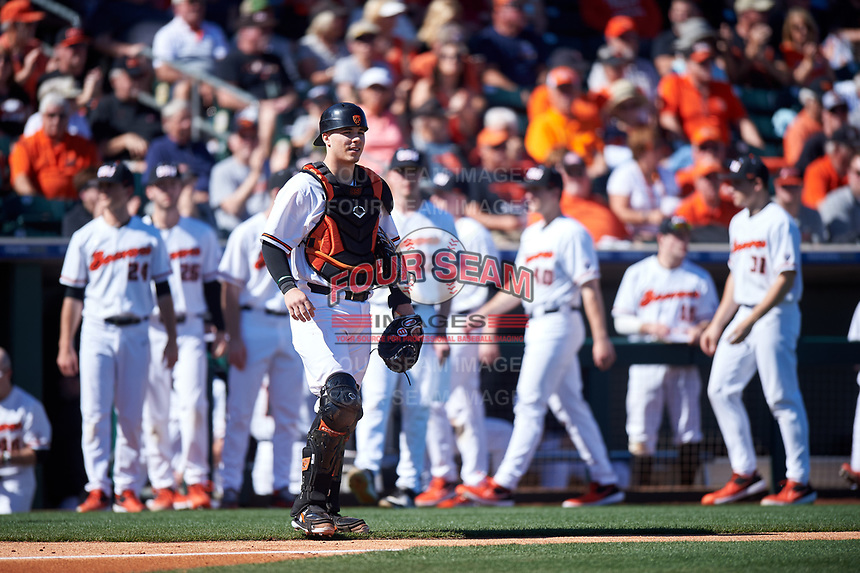Oregon State Beavers Troy Claunch (17) between innings of an NCAA game against the New Mexico Lobos at Surprise Stadium on February 14, 2020 in Surprise, Arizona. (Zachary Lucy / Four Seam Images)
