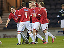 Deveronvale's Scott Fraser (2nd right) celebrates after he scores from the spot ...