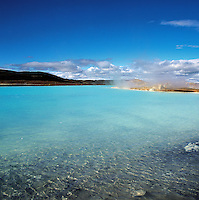 Geothermal lagoon with bright aquamarine water near Myvatn, northern Iceland