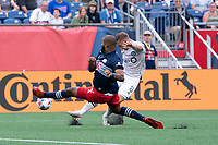 FOXBOROUGH, MA - JULY 25: Djordje Mihailovic #8 of CF Montreal takes a shot at goal deflected by Andrew Farrell #2 of New England Revolution during a game between CF Montreal and New England Revolution at Gillette Stadium on July 25, 2021 in Foxborough, Massachusetts.