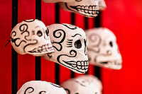 Hand-painted skulls (Calaveras) are seen placed on a street door during the Day of the Dead festival in Oaxaca, Mexico, 31 October 2019. Day of the Dead (Día de Muertos), a religious holiday combining the death veneration rituals of Pre-Hispanic cultures with the Catholic practice, is widely celebrated throughout all of Mexico. Based on the belief that the souls of the departed may come back to this world on that day, people gather together while either praying or joyfully eating, drinking, and playing music, to remember friends or family members who have died and to support their souls on the spiritual journey.