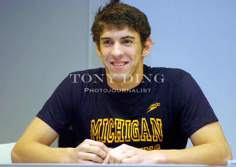 Michigan volunteer assistant coach and 8-time 2004 Olympics medalist Michael Phelps at a press conference after the Wolverines' win over Northwestern on Friday, January 21, 2005 at Canham Natatorium in Ann Arbor, Mich. (Photo by TONY DING/The Michigan Daily)