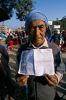 Ex-Servicemen with a photocopy of his release document from the British army, during a GAESO meeting in Kathmandu Nepal..After serving 7 years, 2 months and 6 days for the British Gorkha army and fighting during the World War II, this ex-Servicemen have been thanks without any financial compensation or any pension..-The full text reportage is available on request in Word format.