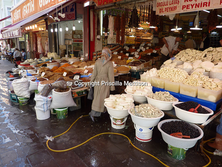 Istanbul, Turkey - September 23, 2009:  A woman enters a food store.