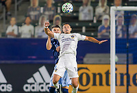 """CARSON, CA - OCTOBER 18: Javier """"Chicharito"""" Hernandez #14 of the Los Angeles Galaxy heads a ball during a game between Vancouver Whitecaps and Los Angeles Galaxy at Dignity Heath Sports Park on October 18, 2020 in Carson, California."""