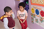 Education Preschool 3-4 year olds girl showing sympathy for sad boy