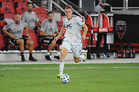 WASHINGTON, DC - AUGUST 25: Adam Buska #9 of New England Revolution moves the ball during a game between New England Revolution and D.C. United at Audi Field on August 25, 2020 in Washington, DC.