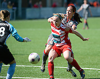 20140419 - ANTWERPEN , BELGIUM : duel pictured between Standard's Vanity Lewerissa (right) and Antwerp Stefanie Van Broeck (middle) during the soccer match between the women teams of RAFC Antwerp Ladies  and Standard Femina  , on the 24th matchday of the BeNeleague competition on Saturday 19 April 2014 in Deurne .  PHOTO DAVID CATRY