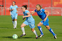 Collette McCallum (14) of Sky Blue FC is chased by Stacy Bishop (4) of the Boston Breakers. Sky Blue FC defeated the Boston Breakers 2-1 during a Women's Professional Soccer match at Yurcak Field in Piscataway, NJ, on May 31, 2009.