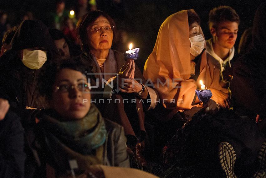 Pilgrims seen here during an evening vigil ahead of the beatification of Pope John Paul ll.