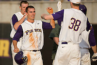 Trent Whitehead #1 of the East Carolina Pirates is congratulated by teammates after scoring a run versus the Elon Phoenix at Clark-LeClair Stadium March 29, 2009 in Greenville, North Carolina. (Photo by Brian Westerholt / Four Seam Images)
