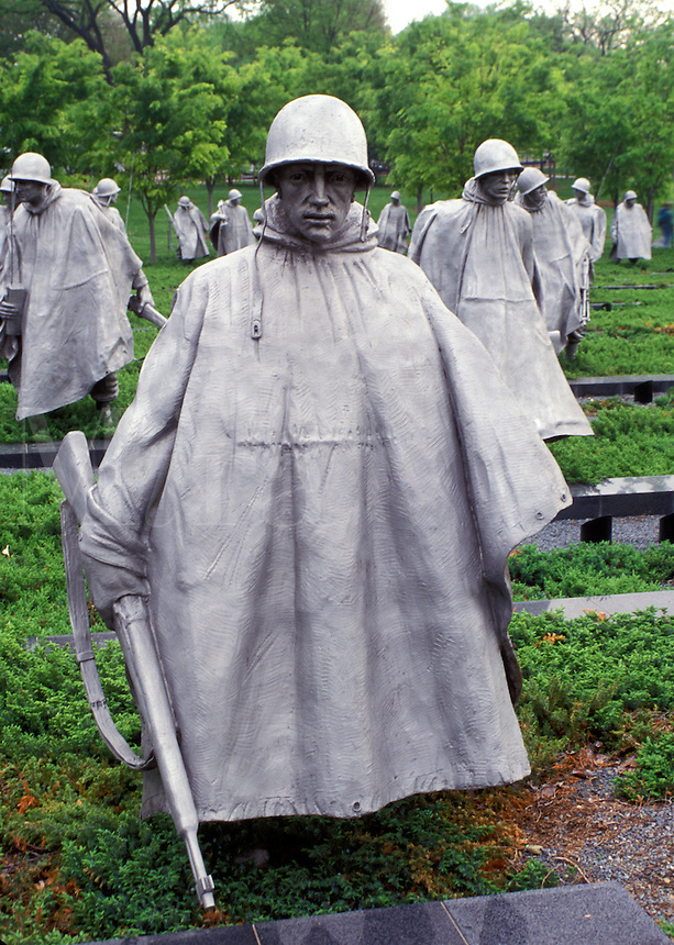 Washington, DC, District of Columbia, Statues of soldiers in ponchos in a rice paddy field at the Korean War Veterans Memorial.