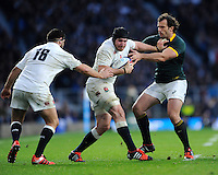 Ben Morgan of England is held by Bismarck du Plessis of South Africa during the QBE International match between England and South Africa at Twickenham Stadium on Saturday 15th November 2014 (Photo by Rob Munro)