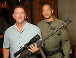 Charles Carter and SWAT team member Ed Lem with a sniper rifle at the Second Annual True Blue Gala sponsored by the Houston Police Foundation at the home of Paige and Tilman Fertitta Saturday Oct. 17,2009. (Dave Rossman/For the Chronicle)