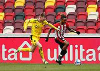 14th February 2021; Brentford Community Stadium, London, England; English Football League Championship Football, Brentford FC versus Barnsley; Mads Juel Andersen of Barnsley challenges Ivan Toney of Brentford