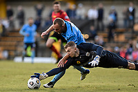 18th April 2021; Leichardt Oval, Sydney, New South Wales, Australia; A League Football, Sydney Football Club versus Adelaide United; Joe Gauci of Adelaide United dives to collect the ball at the feet of Rhyan Grant of Sydney after he mishandled it in the box