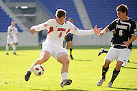 Colin Rolfe (9) of the Louisville Cardinals plays the ball. The Louisville Cardinals defeated the Providence Friars 3-2 in penalty kicks after playing to a 1-1 tie during the finals of the Big East Men's Soccer Championship at Red Bull Arena in Harrison, NJ, on November 14, 2010.