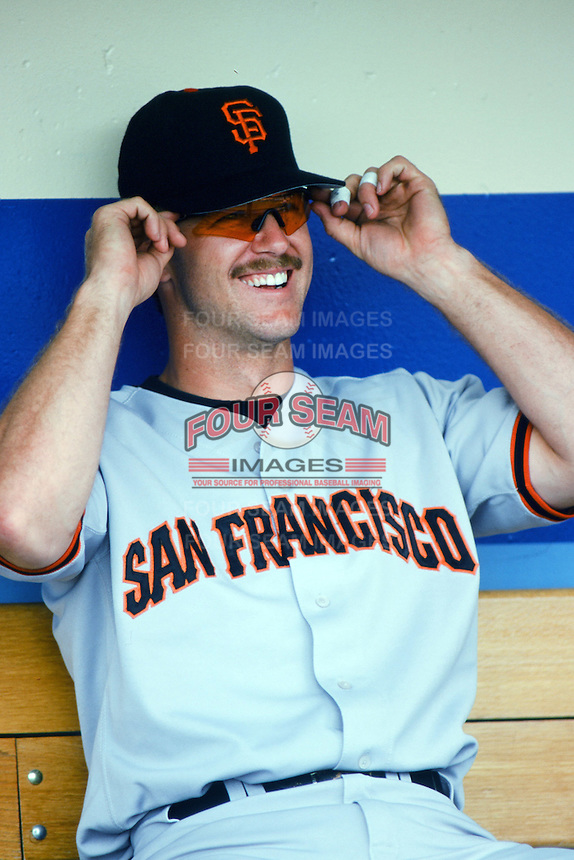 Jeff Kent of the San Francisco Giants sits in the dugout before a 1999 Major League Baseball season game against the Los Angeles Dodgers at Dodger Stadium in Los Angeles, California. (Larry Goren/Four Seam Images)