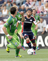 New England Revolution midfielder Lee Nguyen (24) on the attack. In a Major League Soccer (MLS) match, the New England Revolution tied the Seattle Sounders FC, 2-2, at Gillette Stadium on June 30, 2012.