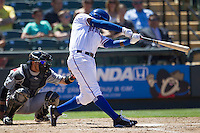 Round Rock shortstop Jurickson Profar (10) swings the bat against the Nashville Sounds in the Pacific Coast League baseball game on May 5, 2013 at the Dell Diamond in Round Rock, Texas. Round Rock defeated Nashville 5-1. (Andrew Woolley/Four Seam Images).