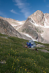 man photographing, hiking, (MR), hike, alpine, photography, tundra, Rowe Peak, high elevation, recreation, outdoors, activity, nature, back country, August, morning, summer, landscape, Rocky Mountain National Park, Colorado, USA