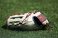 The glove belonging to Travis Honeyman (not pictured) sits on the turf prior to the NCAA baseball game against the Virginia Tech Hokies at English Field on April 3, 2021 in Blacksburg, Virginia. (Brian Westerholt/Four Seam Images)